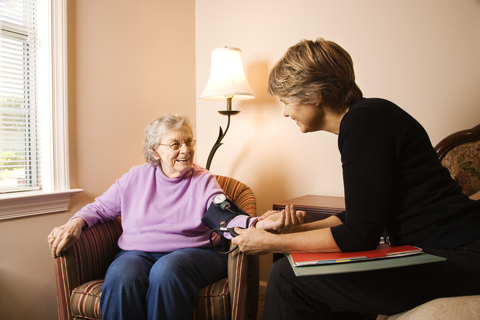 http://www.dreamstime.com/royalty-free-stock-photos-elderly-woman-having-blood-pressure-taken-image12619878
