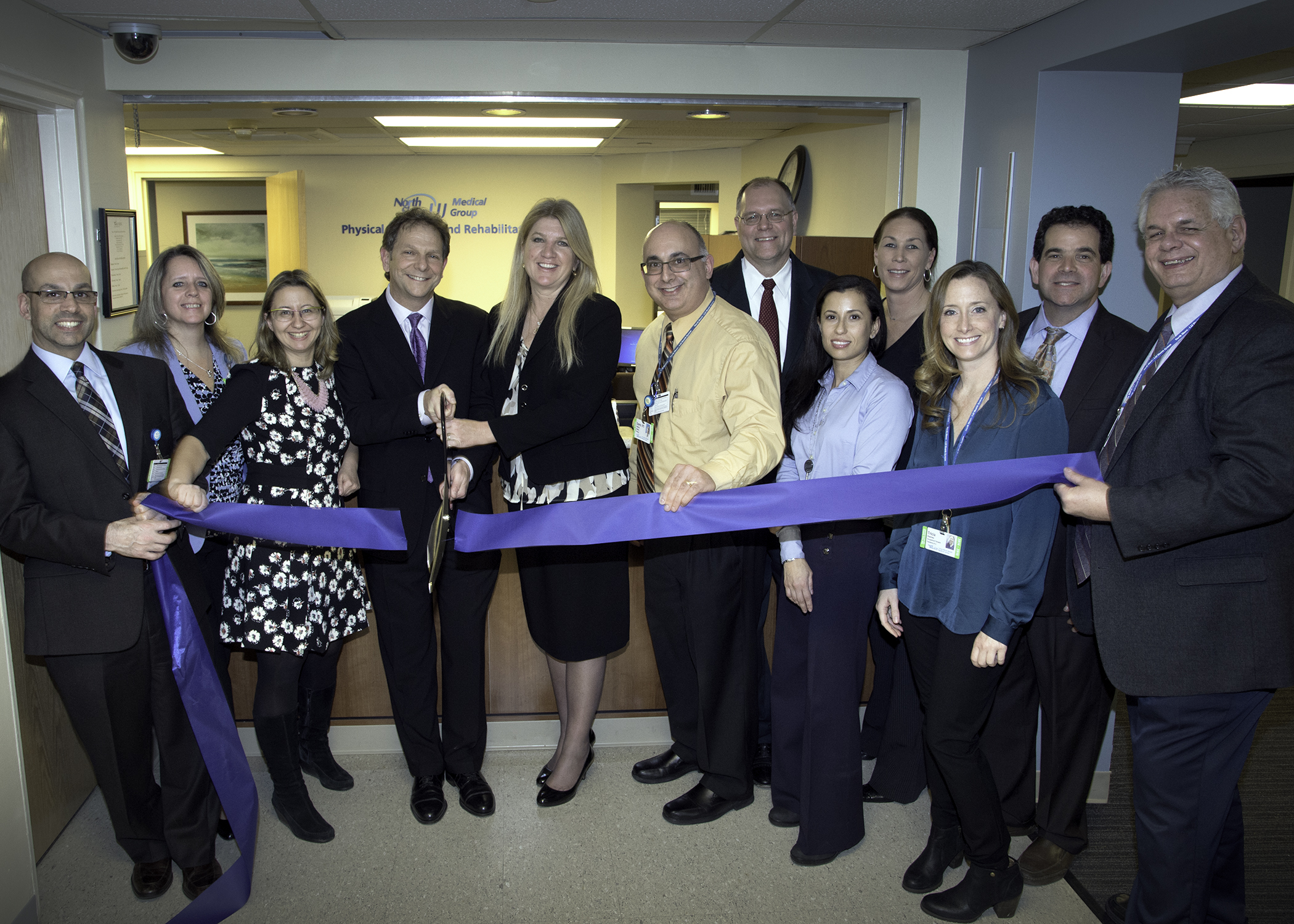 Members of the North Shore-LIJ Health System physical medicine and rehabilitation team cut the ribbon for their new Manhasset rehabilitation center.