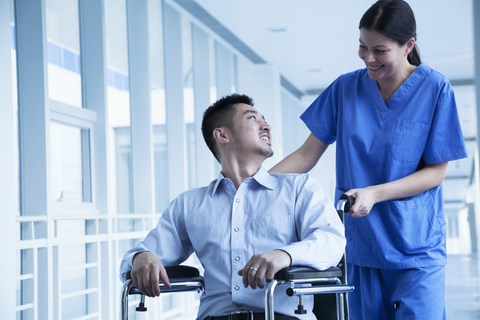 http://www.dreamstime.com/stock-photo-smiling-female-nurse-pushing-assisting-patient-wheelchair-hospital-image33401740