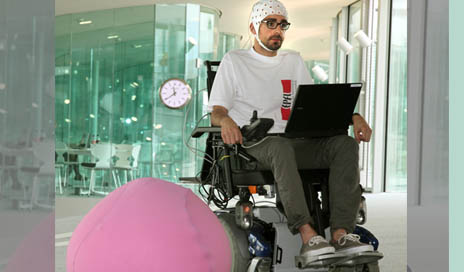 "A brain-controlled wheelchair designed to be operated reliably and safely over long periods of time via ""shared control"" technology. Device designer José del R. Millán says the wheelchair illustrates the future of intelligent neuroprostheses. (Image courtesy of José del R. Millán)"